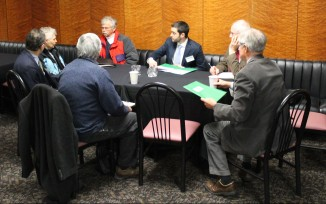 Advocates meet to discuss strategy before meeting with their legislators.